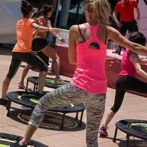 RIMINI, ITALY - MAY 2015: Pretty Girl with Pink Sportswear Having Exercise on Rebounder